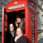 friends in red telephone booth london